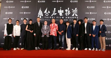 """The team of movie """"Detention"""" pose on the red carpet at the 2020 Taipei Film Festival in Taipei, Taiwan, Saturday, July 11, 2020."""
