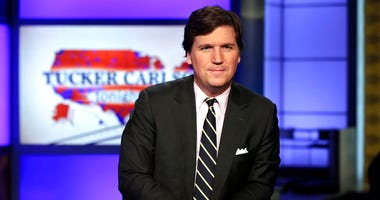 "FILE - In this March 2, 2017 file photo, Tucker Carlson, host of ""Tucker Carlson Tonight,"" poses for photos in a Fox News Channel studio, in New York."