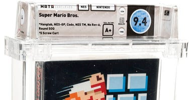 This photo provided by Heritage Auctions on Saturday, July 11, 2020, shows the front of an unopened copy of a vintage Super Mario Bros. video game that has been sold for $114,000 in an auction that underscored the enduring popularity of entertainment crea