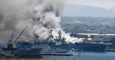 moke rises from the USS Bonhomme Richard at Naval Base San Diego Sunday, July 12, 2020, in San Diego after an explosion and fire Sunday on board the ship at Naval Base San Diego.