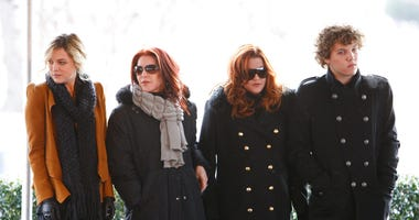 FILE - In this Jan. 8, 2010, file photo, Priscilla Presley, second from left, her daughter, Lisa Marie Presley, second from right, and Lisa Marie's children, Riley Keough, left, and Benjamin Keough, right, take part in a ceremony in Memphis, Tenn., commem