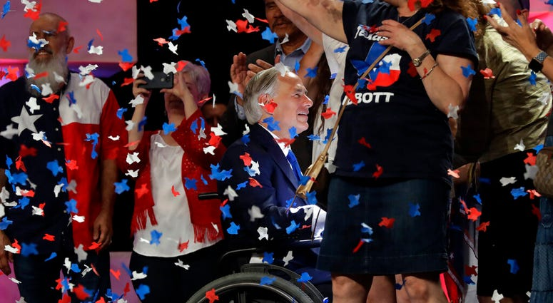 File - In this June 15, 2018 file photo, Confetti falls as Texas Gov. Greg Abbott, center, greets supporters after speaking at the Texas GOP Convention, in San Antonio.