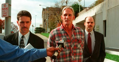 In this 1998 photo, Wesley Ira Purkey, center, is escorted by police officers in Kansas City, Kan., after he was arrested in connection with the death of 80-year-old Mary Ruth Bales.