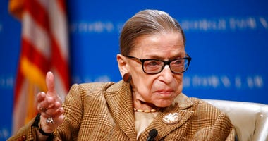 ILE - In this Feb. 10, 2020, file photo U.S. Supreme Court Associate Justice Ruth Bader Ginsburg speaks during a discussion on the 100th anniversary of the ratification of the 19th Amendment at Georgetown University Law Center in Washington.