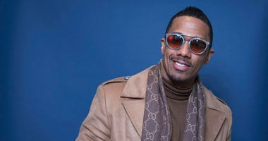 "FILE - In this Dec. 10, 2018, file photo Nick Cannon poses for a portrait in New York. Cannon's ""hateful speech"" and anti-Semitic conspiracy theories led ViacomCBS to cut ties with the performer, the media giant said."