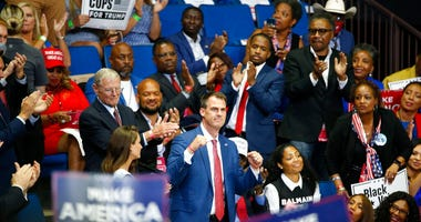 FILE - In this June 20, 2020 file photo, Oklahoma Gov. Kevin Stitt is recognized as President Donald Trump speaks during a campaign rally at the BOK Center, in Tulsa, Okla.