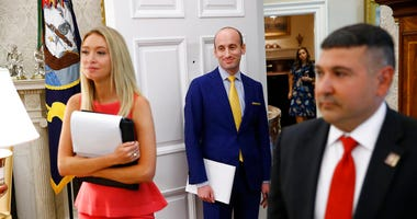 President Donald Trump's White House Senior Adviser Stephen Miller, center, stands in the Oval Office of the White House during a law enforcement briefing on the MS-13 gang, Wednesday, July 15, 2020, in Washington.