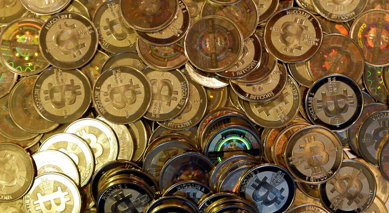 FILE - This April 3, 2013, file photo shows bitcoin tokens in Sandy, Utah.
