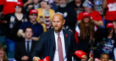 "FILE - In this Thursday, March 28, 2019, file photo, Brad Parscale, manager of President Donald Trump's reelection campaign, throws ""Make America Great Again,"" hats to the audience before a rally in Grand Rapids, Mich."