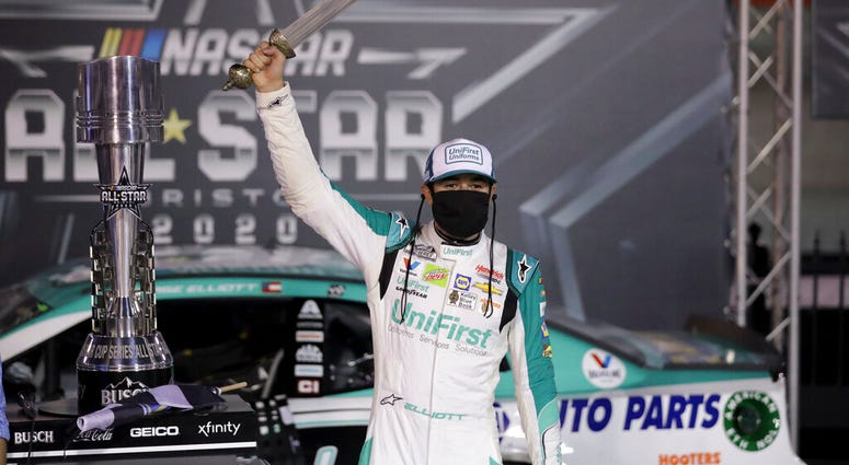 Chase Elliott celebrates with the trophy after winning a NASCAR All-Star auto race at Bristol Motor Speedway in Bristol, Tenn, Wednesday, July 15, 2020.