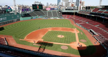 Boston Red Sox baseball players practice at Fenway Park, Thursday, July 16, 2020, in Boston.