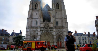 Fire fighters brigade work to extinguish the blaze at the Gothic St. Peter and St. Paul Cathedral, in Nantes, western France, Saturday, July 18, 2020.