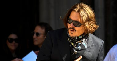Actor Johnny Depp arrives at the High Court, in London, Monday July 20, 2020.