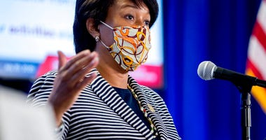 District of Columbia Mayor Muriel Bowser wears a face mask to protect against the spread of the coronavirus outbreak, as she speaks at a news conference on the coronavirus and the District's response, Monday, July 20, 2020 in Washington.