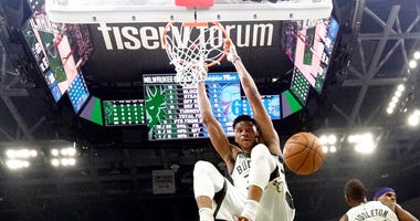 FILE - In this Feb. 22, 2020, file photo, Milwaukee Bucks' Giannis Antetokounmpo dunks during the first half of an NBA basketball game against the Philadelphia 76ers in Milwaukee. (AP Photo/Morry Gash, File)