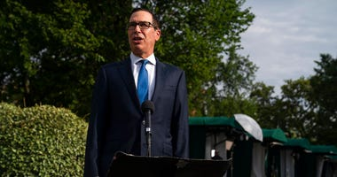 Treasury Secretary Steven Mnuchin speaks with reporters about the coronavirus relief package negotiations, at the White House, Thursday, July 23, 2020, in Washington.