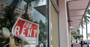 FILE - In this July 13, 2020, file photo a For Rent sign hangs on a closed shop during the coronavirus pandemic in Miami Beach, Fla.
