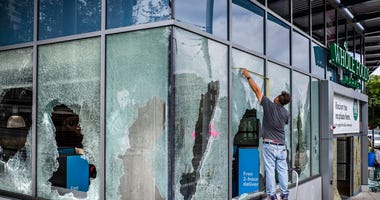 Broken in glass windows were being repaired on the Whole Foods Market at Broadway and Madison St., in Seattle, on Thursday, July 23, 2020, after people bashed them last night.