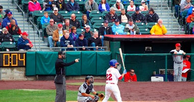 FILE - In this April 9, 2015, file photo, home plate umpire Seth Buckminster signals for the pitch as Buffalo Bisons batter Josh Thole (22) steps into the box during a Triple-A baseball game between the Bisons and Rochester Red Wings in Buffalo, N.Y.