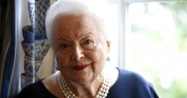 FILE - In this June 18, 2016, file photo, U.S. actress Olivia de Havilland poses during an Associated Press interview, in Paris. Olivia de Havilland, Oscar-winning actress has died, aged 104 in Paris, publicist says Sunday July 26, 2020.