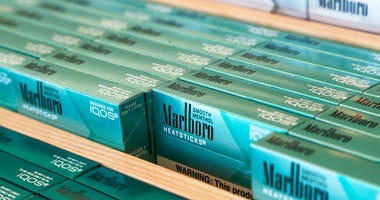 FILE - This Nov. 25, 2019 photo shows IQOS heated cigarette heatsticks displayed in an IQOS store in Richmond, Va. (AP Photo/Steve Helber, File)