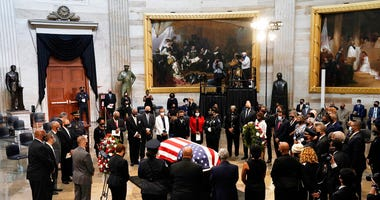 Members of the Congressional Black Caucus, say farewell at the conclusion of a service for the late Rep. John Lewis, D-Ga.. (AP Photo/J. Scott Applewhite, Pool)