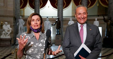 House Speaker Nancy Pelosi of Calif., left, and Senate Minority Leader Sen. Chuck Schumer of N.Y., speak to the media, Tuesday, July 28, 2020, on Capitol Hill in Washington. (AP Photo/Jacquelyn Martin)