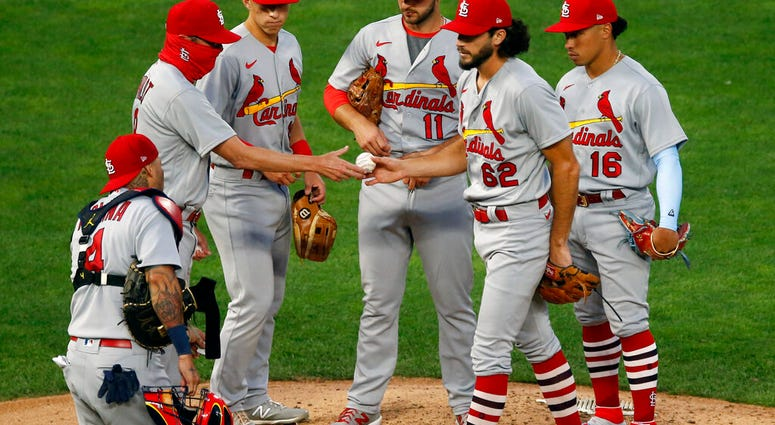 St. Louis Cardinals pitcher Daniel Ponce de Leon hands the ball over to manager Mike Shildt, left, after being pulled in the fifth inning of the team's baseball game against the Minnesota Twins on Wednesday, July 29, 2020, in Minneapolis.