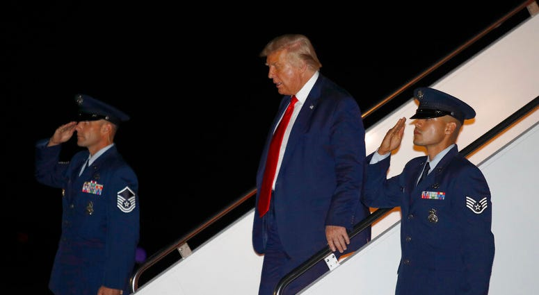 President Donald Trump steps off Air Force One at Andrews Air Force Base, Md., Friday, July 31, 2020. Trump is returning to Washington after attending events in Florida.