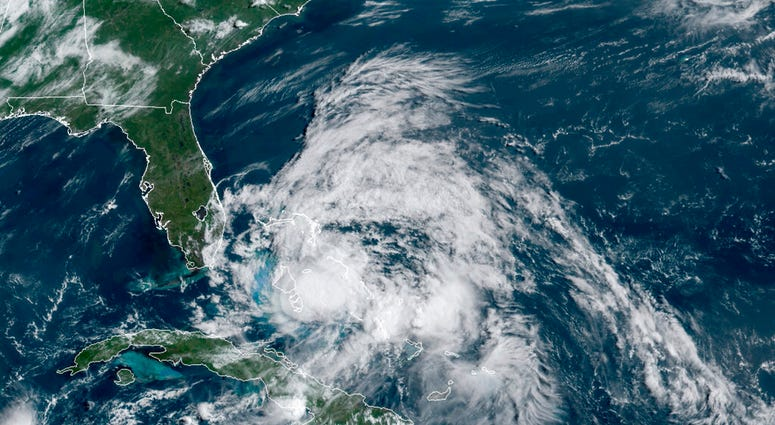 This GOES-16 GeoColor satellite image taken Saturday, Aug. 1, 2020, at 9:40 a.m. EDT., and provided by NOAA, shows Hurricane Isaias over the Bahamas.