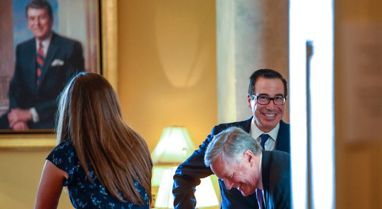 Treasury Secretary Steven Mnuchin, right, and White House Chief of Staff Mark Meadows, second from right, sit down in the office of Senate Majority Leader Mitch McConnell of Ky., on Capitol Hill in Washington, Monday, Aug. 3, 2020.