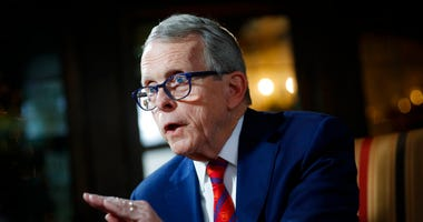 FILE - In this Dec. 13, 2019, file photo, Ohio Gov. Mike DeWine speaks during an interview at the Governor's Residence in Columbus, Ohio.