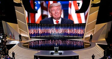 FILE - In this July 21, 2016, file photo, Republican presidential candidate Donald Trump smiles as he addresses delegates during the final day session of the Republican National Convention in Cleveland.