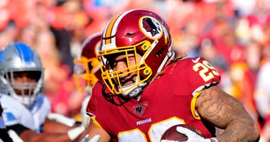 FILE - In this Nov. 24, 2019, file photo, Washington Redskins running back Derrius Guice (29) runs the ball during an NFL football game against the Detroit Lions in Landover, Md.