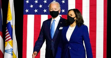 Democratic presidential candidate former Vice President Joe Biden and his running mate Sen. Kamala Harris, D-Calif., arrive to speak at a news conference at A.I.Dupont High School in Wilmington, Del., Wednesday, Aug. 12, 2020. (AP Photo/Carolyn Kaster)