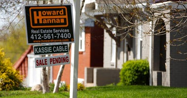 FILE - This Monday, April 27, 2020, file photo shows a sale pending sign on a home in Mount Lebanon, Pa.