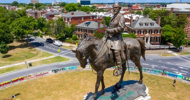 This July 10, 2020 file photo shows the statue of Confederate General Robert E. Lee. (AP Photo/Steve Helber)