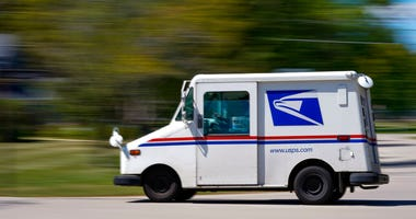 A mail truck moves down a street Tuesday, Aug. 18, 2020, in Fox Point, Wis. (AP Photo/Morry Gash)