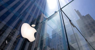 FILE - In this June 16, 2020 file photo, the sun is reflected on Apple's Fifth Avenue store in New York.  (AP Photo/Mark Lennihan, File)