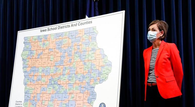 In this July 30, 2020, file photo, Iowa Gov. Kim Reynolds listens to a question during a news conference on the state's guidance for returning to school in response to the coronavirus outbreak in Des Moines, Iowa. (AP Photo/Charlie Neibergall, File)