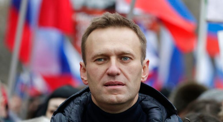 In this Sunday, Feb. 24, 2019 file photo, Russian opposition activist Alexei Navalny takes part in a march in memory of opposition leader Boris Nemtsov in Moscow, Russia. (AP Photo/Pavel Golovkin, File)