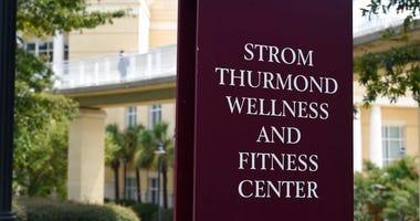 A sign advertises the Strom Thurmond Wellness and Fitness Center on Thursday, Aug. 20, 2020, in Columbia, S.C. (AP Photo/Meg Kinnard)