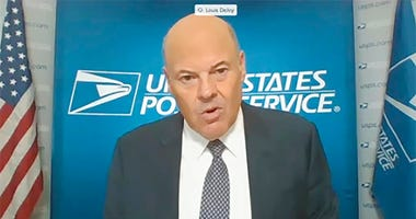 In this image from video, U.S. Postmaster General Louis DeJoy testifies during a virtual hearing before the Senate Governmental Affairs Committee on the U.S. Postal Service during COVID-19 and the upcoming elections, Friday, Aug. 21, 2020 on Capitol Hill