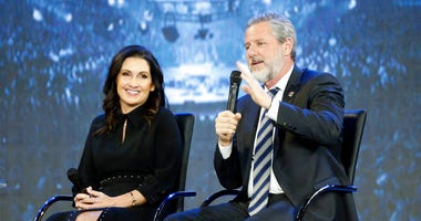 FILE -This Wednesday Nov. 28, 2018 file photo shows Rev. Jerry Falwell Jr., right, and his wife, Becki during after a town hall at a convocation at Liberty University in Lynchburg, Va.
