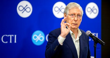 U.S. Senate Majority Leader Mitch McConnell speaks at a press conference at the CTI clinical trials and consulting services offices in Covington, Kentucky on Monday, August 24, 2020. (Meg Vogel/The Cincinnati Enquirer via AP)