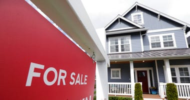 "FILE - In this April 1, 2020 photo, a ""For Sale"" sign stands in front of a home that is in the process of being sold in Monroe, Wash. (AP Photo/Elaine Thompson, File)"