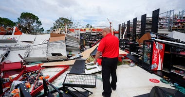 An auto parts store employee surveys the damage to the facilty on Thursday, Aug. 27, 2020, in Lake Charles, La., in the aftermath of Hurricane Laura. (AP Photo/Gerald Herbert)