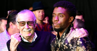 """FILE - In this Jan. 29, 2018 file photo, comic book legend Stan Lee, left, creator of the """"Black Panther"""" superhero, poses with Chadwick Boseman, star of the new """"Black Panther"""" film, at the premiere at The Dolby Theatre in Los Angeles."""