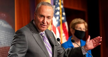 Senate Minority Leader Sen. Chuck Schumer of N.Y., left, with Sen. Elizabeth Warren, D-Mass., speaks during a news conference, Wednesday, Sept. 9, 2020, on Capitol Hill in Washington. (AP Photo/Jacquelyn Martin)