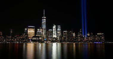 FILE - In this Sept. 11, 2017, file photo, the Tribute in Light illuminates in the sky above the Lower Manhattan area of New York, as seen from across the Hudson River in Jersey City, N.J.